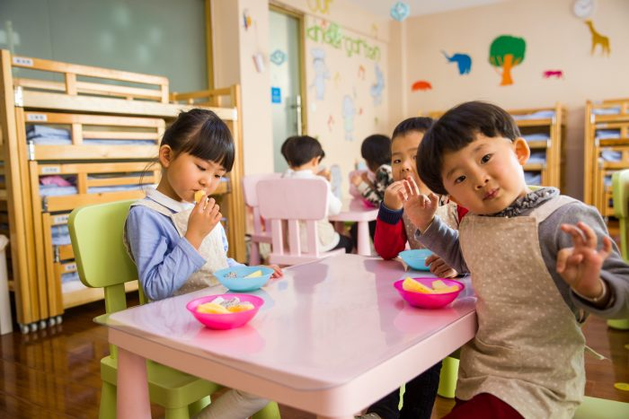 Preschool kids eating JotForm Educational Technology