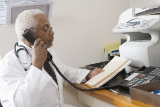 Doctor on the phone, ready to send a HIPAA-compliant fax