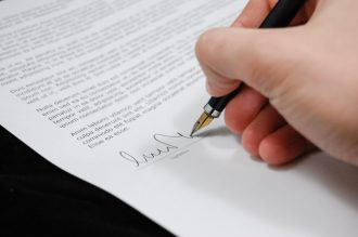 Person signing for a signature loan