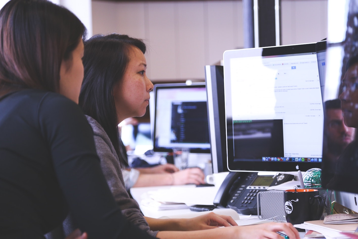 persons using an erp software in office environment