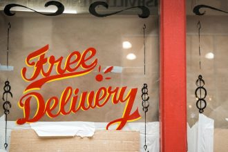 free delivery sign on a restaurant window
