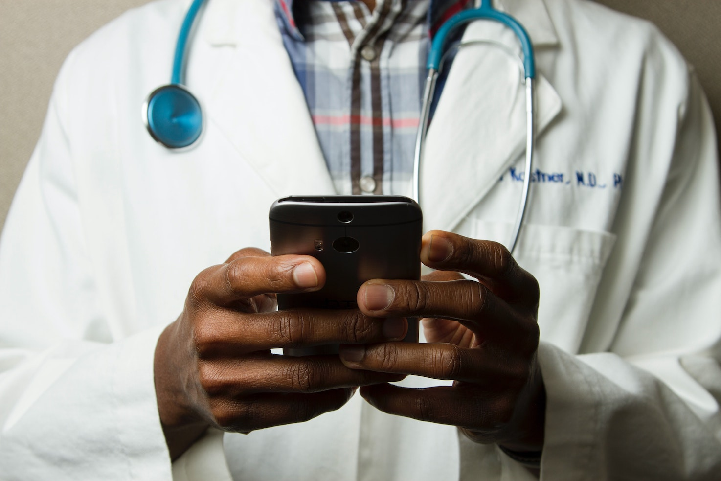 doctor providing telemedicine service with his phone