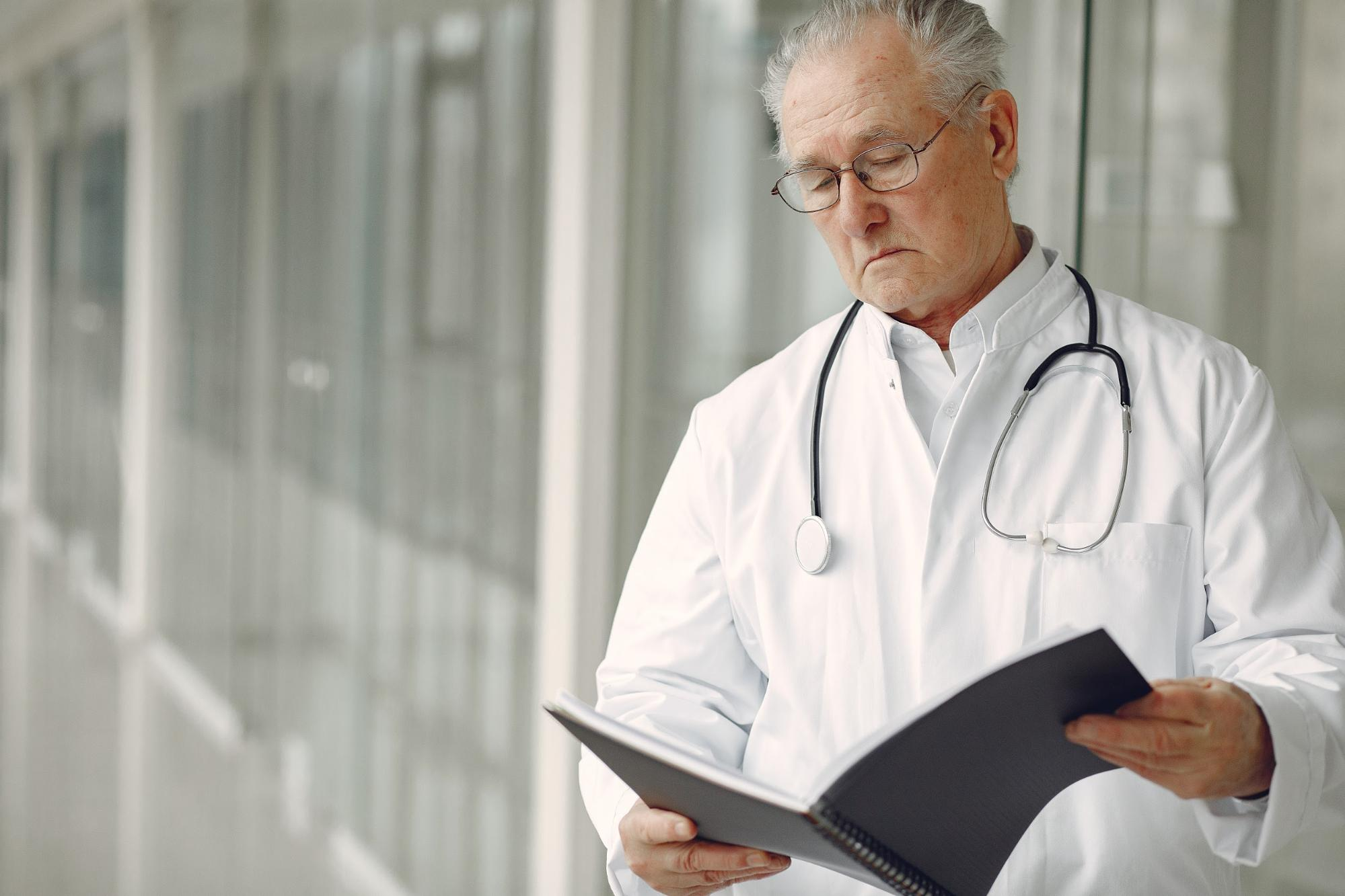 A medical provider reviews a patient's notes.