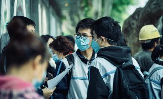 students with masks after reopening of schools