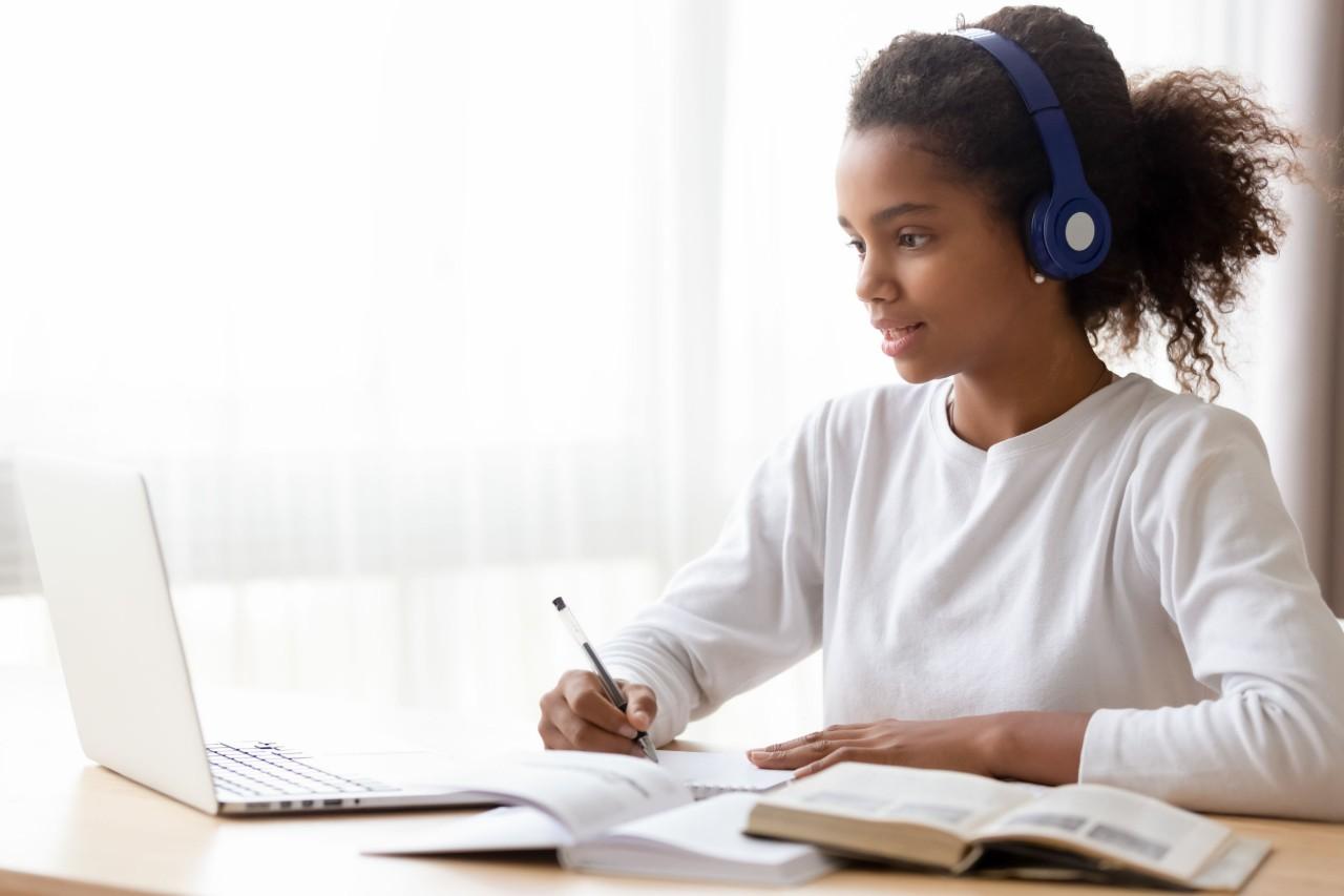 A pupil attending a class using an online teaching platform.