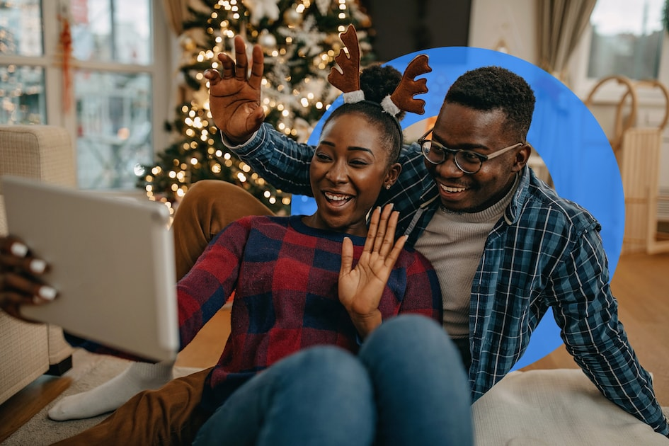 A couple attending a virtual holiday party